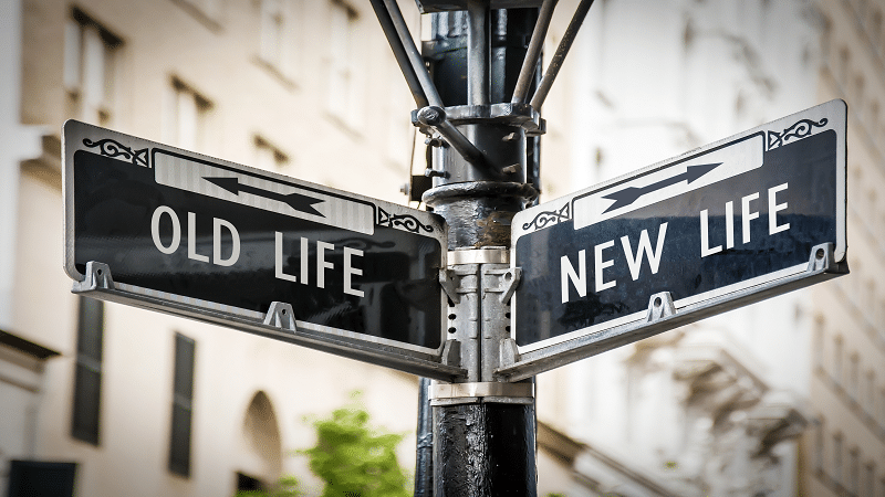 Street sign saying 'old life' and 'new life'